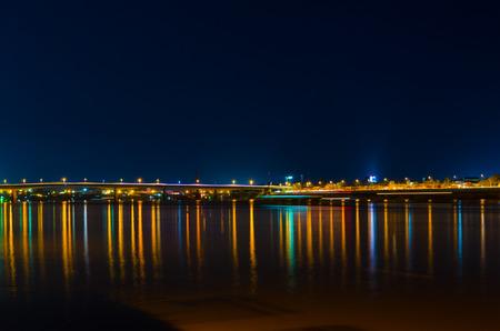 tonle sap: bridge and embankment lights reflect in Tonle Sap river Stock Photo