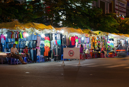 night shirt: HO CHI MINH, VIETNAM - JULY 10, 2014: Unidentified people sell clothes and souvenirs in tents established for a night around the Ben Thanh market.