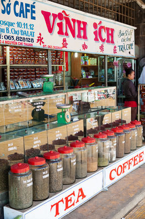 shopgirl: DALAT, VIETNAM - AUGUST 2, 2014: An unidentified woman sells tea and coffee at the city central market (Cho Da Lat), one of major tourist attractions in the city.