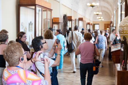 ST. PETERSBURG - JUNE 30, 2011: A group of unidentified tourists have a guided tour in the Hermitage, the biggest in Russia. To see all the displays one should walk 20 kilometers.