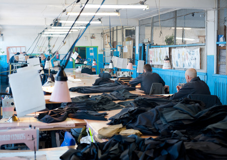 penal institution: ULAN-UDE, RUSSIA - NOVEMBER 18, 2011: Unidentified men prisoners sew uniforms at a sewing workshop. To have job in modern Russian jail is luck as unemployment has come even there. Editorial