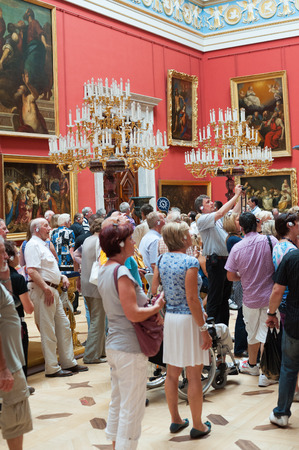 guided: ST. PETERSBURG - JUNE 30, 2011: A group of unidentified tourists have a guided tour in the Hermitage, the biggest in Russia. To see all the displays one should walk 20 kilometers. Editorial