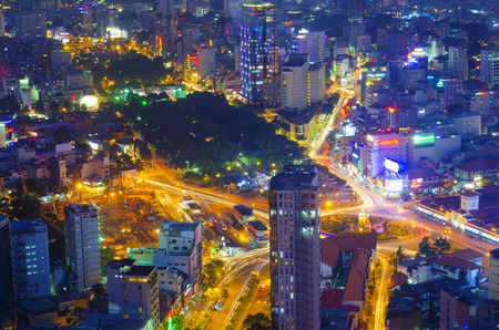 lao: HO CHI MINH, VIETNAM - JULY 11, 2014: A night view at the downtown - the park in Pham Ngu Lao Street and the Ben Thanh market from the Bitexco Financial Tower.
