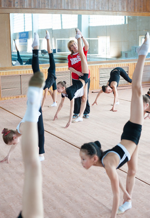 life extension: ULAN-UDE, RUSSIA - APRIL 28, 2011: Trainer Svetlana Bogatykh coaches girls in Gratsia rhythmic gymnastics studio, City Palace of Childrens Arts, the biggest centre offering childrens hobby circles. Editorial
