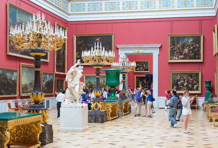 hermitage: ST. PETERSBURG - JUNE 30, 2011: Unidentified tourists watch paintings and sculptures at the Hermitage. Over 3 million people visit the museum every year.