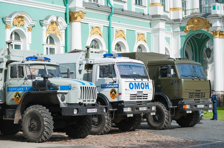 riot: ST PETERSBURG - JUNE 29, 2011: Some trucks of police emergency platoons stand near the Hermitage. It is the last day of the City celebrations on the 308th anniversary held in Palace Square. Editorial