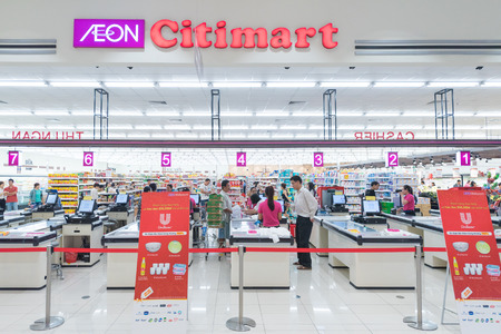 cashier: HO CHI MINH, VIETNAM - JAN 13, 2015: Unidentified people buy at a Citimart supermarket. Supermarkets are uncommon in Vietnam, open air markets and small businesses are the main players in retailing. Editorial