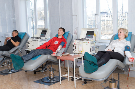 ulan ude: ULAN-UDE, RUSSIA - APRIL 6, 2010: Unidentified volunteers donate blood at the City Blood Service which makes a promo action for donorship popularization.