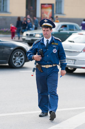 traffic police: ST PETERSBURG - MAY 29, 2011: An unidentified traffic policeman inspects traffic near Palace Square. Personal vehicles are limited on the last day of the City celebrations on the 308th anniversary.