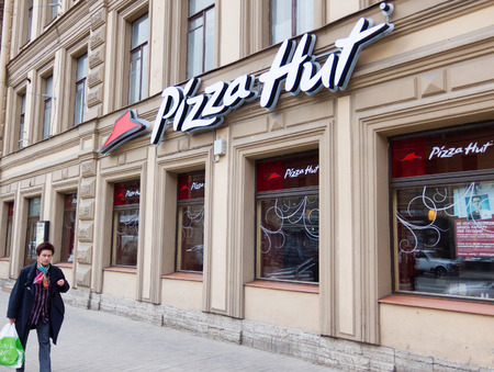 hut: ST.PETERSBURG - MAY 29, 2011: A Pizza Hut restaurant in Nevsky Prospekt. Pizza Hut, Inc. is a subsidiary of Yum! Brands, Inc., the worlds largest restaurant company. Editorial