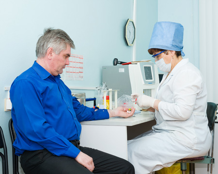 2 50: ULAN-UDE, RUSSIA - APRIL 6, 2010: An unidentified nurse makes blood test for volunteers before they donate blood.The City Blood Service makes a promo action for donorship popularization. Editorial