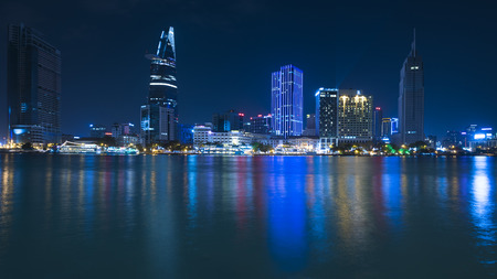 developing country: HO CHI MINH, VIETNAM - FEB 07, 2015: A view of night downtown across the Saigon river. Vietnam nowadays is a rapidly developing country.