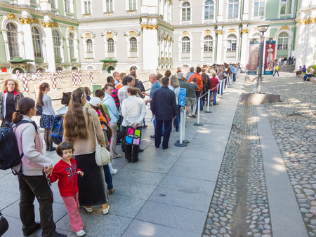 ST. PETERSBURG - MAY 31, 2011: A lot of people stand in a queue to the ticket office of the Hermitage Museum. Over 3 million people visit the museum every year. Editorial