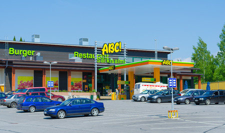 retailing: SARKISALMI, FINLAND - JUNE 1, 2011: Several cars are parked at an ABC service station. The highly developed chain is owned by the S Group, a Finnish retailing cooperative organization.
