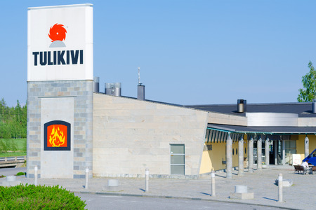soapstone: JUUKA, FINLAND - JUNE 1, 2011: The Tulikivi company facade. The company is one of the worlds leaders in production of masonry heaters and stoves of soapstone - tulikivi (Finnish). Editorial
