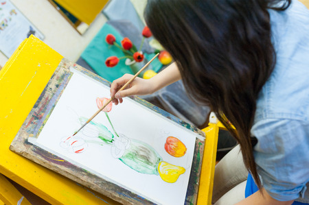 ulan ude: ULAN-UDE, RUSSIA - MAY 10, 2011: An unidentified girl paints at a drawing school of the City Palace of Childrens and Junior Arts, the biggest centre offering hobby circles and studies for children.
