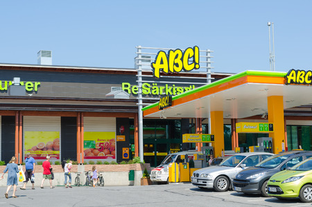 retailing: SARKISALMI, FINLAND - JUNE 1, 2011: Unidentified people go in an ABC service station. The highly developed chain is owned by the S Group, a Finnish retailing cooperative organization. Editorial
