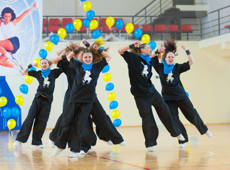 ulan ude: ULAN-UDE, RUSSIA - MAY 2, 2010: Unidentified young women in black suits perform their expressive number at the Festival of aerobics and fitness.