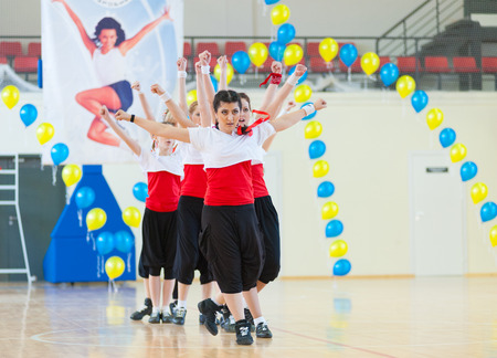 ulan ude: ULAN-UDE, RUSSIA - MAY 2, 2010: Unidentified young women in red and white shirts perform their number at the Festival of aerobics and fitness. Editorial