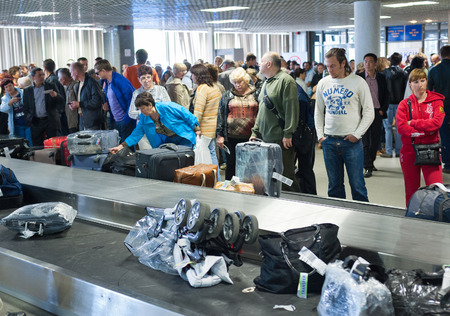 travelled: ST. PETERSBURG - MAY 28, 2011: Unidentified passengers wait for baggage at Pulkovo airport. In 2013 roughly 12.85 mln ppeople travelled there, making it the 3rd busiest airport in Russia.