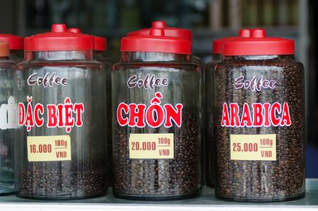 define: Different sorts of coffee in jars. Vietnamese words define coffee sorts.