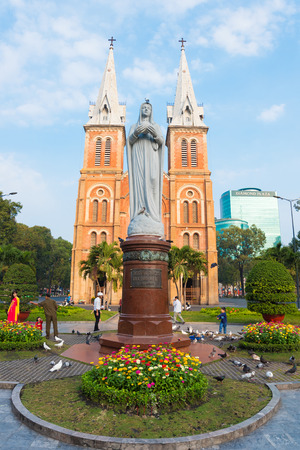 dame: HO CHI MINH, VIETNAM - FEB 18, 2015: Saigon Notre Dame Basilica facade on Tet Eve. Established by French colonists, the cathedral was constructed between 1863 and 1880.