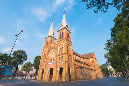 notre: HO CHI MINH, VIETNAM - FEB 18, 2015: Saigon Notre Dame Basilica on Tet Eve. Established by French colonists, the cathedral was constructed between 1863 and 1880. Editorial