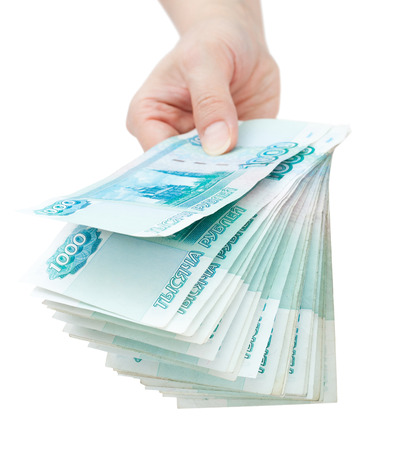 encash: hand offer batch of many 1000 rouble bills (the 2nd biggest Russian bond) Stock Photo