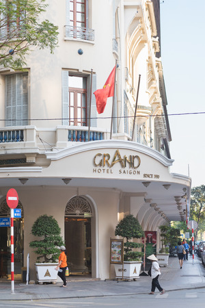 m hotel: HO CHI MINH, VIETNAM - JAN 15, 2015: Unidentified people walk by the entrance of Rex Hotel. This luxurious hotel is located in the main city shopping street in 50 m from the Saigon river.