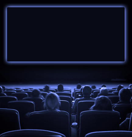 viewers watch motion picture at movie theatre, long exposure, blue toning