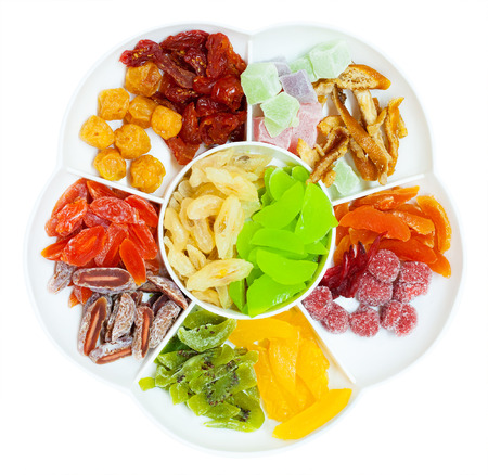 sectioned: assorted dried fruit in sectioned plate, top view Stock Photo