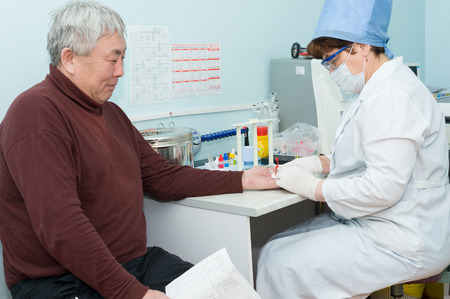 ulan ude: ULAN-UDE, RUSSIA - APRIL 6, 2010: An unidentified nurse makes blood test for volunteers before they donate blood. The City Blood Service makes a promo action for donorship popularization.