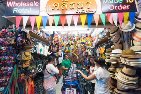 travelling salesman: BANGKOK - MARCH 9, 2015: Unidentified people buy at a souvenir shop in Khao San Road Street. It is called the heart of backpackers universe. Editorial