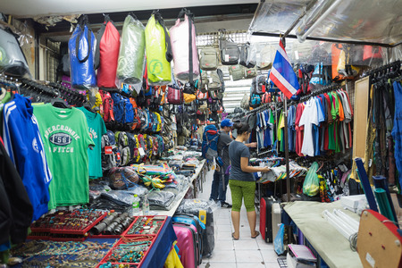 travelling salesman: BANGKOK - MARCH 9, 2015: Unidentified people buy at a shop in Khao San Road Street. It is called the heart of backpackers universe. Editorial
