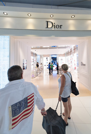 BANGKOK - MARCH 18; 2015: Unidentified people shop at a duty free Dior boutique at the International Airport Suvarnabhumi which is the sixth busiest airport in Asia.