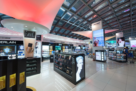 BANGKOK - MARCH 18; 2015: Unidentified people shop at duty free cosmetics boutiques at the International Airport Suvarnabhumi which is the sixth busiest airport in Asia.