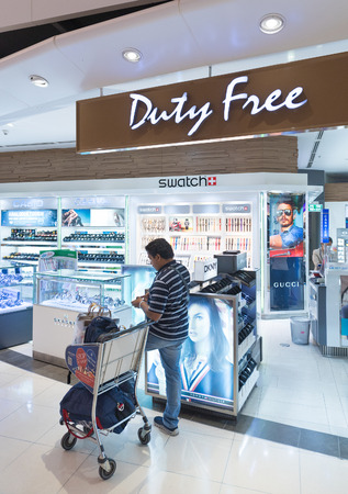 BANGKOK - MARCH 18; 2015: An unidentified man shops at a duty free watches shop at the International Airport Suvarnabhumi which is the sixth busiest airport in Asia. Editorial