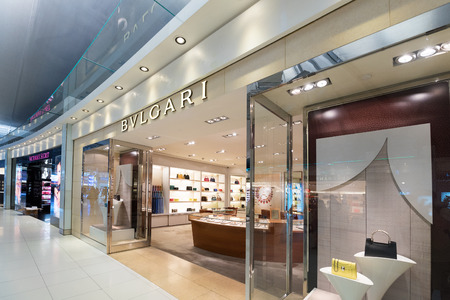 luxury goods: BANGKOK - MARCH 18; 2015: Bvlgari and Victorias Secret duty free boutiques at the International Airport Suvarnabhumi which is the sixth busiest airport in Asia. Editorial