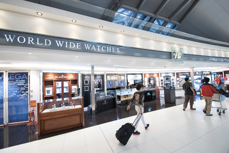 duties: BANGKOK - MARCH 18; 2015: Unidentified people shop at duty free watches boutiques at the International Airport Suvarnabhumi which is the sixth busiest airport in Asia. Editorial