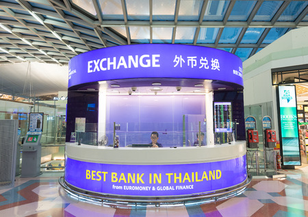 euromoney: BANGKOK - MARCH 18, 2015: An exchange currency booth at the International Airport Suvarnabhumi which is the sixth busiest airport in Asia.