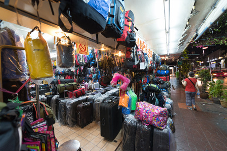 BANGKOK - MAR 9, 2015: A lot of bags and backpacks are sold at a shop in Samsen Road, not far from Khao San Road. This tourist area is full of budget hotels, guesthouses and restaurants.