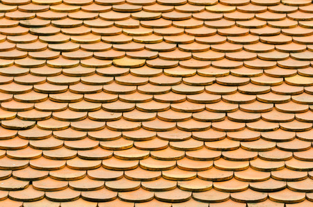 rounded: a lot of rounded brown roof tiles