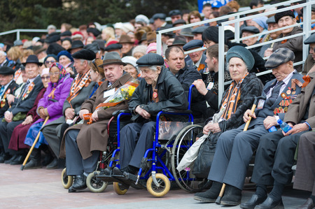 lasted: ULAN-UDE, RUSSIA - MAY 9, 2010: Unidentified senior veterans of WW2 sitting at tribunes watch the parade on annual Victory Day. World War 2 lasted for 6 years from September 1, 1939 till September 2, 1945.