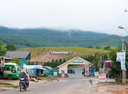 lang: DALAT, VIETNAM - JULY 30, 2014: An entrance arch to the foot of Lang Biang mountain. Its height is 1,900m and one can walk there by a 3 hours hike, or can ride by a jeep.