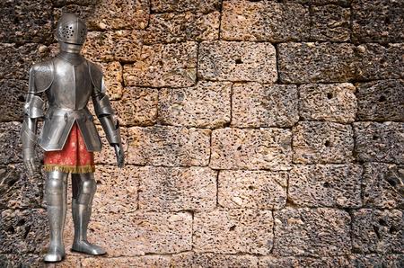 legging: knight against ancient stone wall of bricks