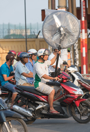 means of transportation: HOCHIMINH VIETNAM APRIL 19 2015: An unidentified motorcyclist drives an electric fan in Truong Chinh Street during rush hours. The main means of cargo transportation in Vietnam is motorcycle. Editorial