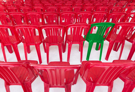 notable: one green chair among many red ones