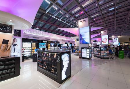 gucci store: BANGKOK - MARCH 18; 2015: Unidentified people shop at duty free cosmetics boutiques at the International Airport Suvarnabhumi which is the sixth busiest airport in Asia.