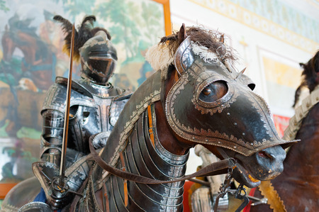 hermitage: ST. PETERSBURG - JUNE 30, 2011: One of knights mannequins on horses at Knights Hall of the Hermitage. It hosts a part of the Hermitage Arsenal collection.