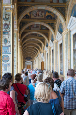 simultaneous: ST. PETERSBURG - JUNE 30, 2011: A group of unidentified tourists have a guided tour in the Hermitage, the biggest in Russia. To see all the displays one should walk 20 kilometers. Editorial